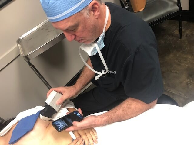 Dr. Bill Hedden using a Clarius scanner